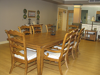 This spacious dining room is available by reservation for family events with residents.