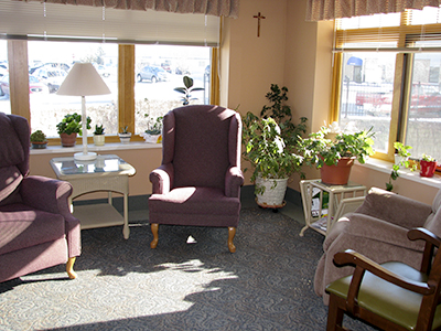 This sunroom offers a cozy place to soak up some sun when the weather is cold outside.