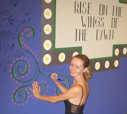 Anna signs the artist wall