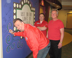 Big Red Rawkit Riot signs the wall at ABHC after playing