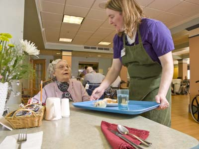 Staff serve residents their choice of meals off the menu.