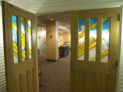Beautiful stained glass doors mark the entrance to the chapel.