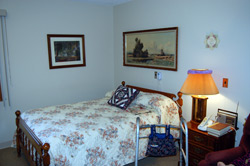 A bedroom in Assisted Living apartment.