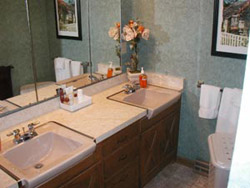 A full bathroom is located between every two bedrooms. Towels and linens are provided. Guests are encouraged to bring their own personal care products.