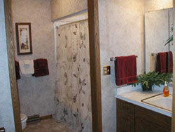 This adjacent bathroom is equipped with a shower chair, elevated stool and other safety features. All bathrooms have safety equipment.
