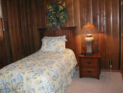 A single room provides cozy accommodations for individuals or family members. Guests may bring their favorite pillow from home, if they wish.