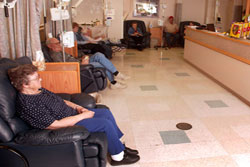 Eight comfortable, reclining chemotherapy administration chairs are located in a pleasant, well-lit area. A comfortable companion chair, television and DVD player are also located in this unit of the Avera Cancer Institute Mitchell.