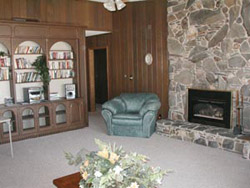 The 'quiet living room' offers a relaxing, peaceful atmosphere. Books, puzzles, and games, all donated by generous friends of the House, are available for guests to enjoy. The gas fireplace offers a cozy warmth on chilly days and evenings.