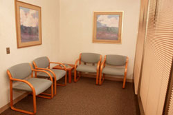 Patients may change into treatment attire in a private room attached to this patient waiting area.