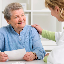 Woman talking with nurse