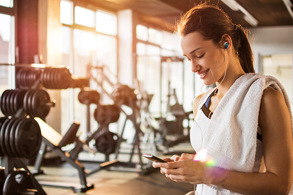 woman exercising listening to music