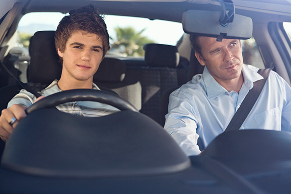 father with son driving the car