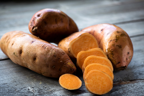 sweet potatoes on a board