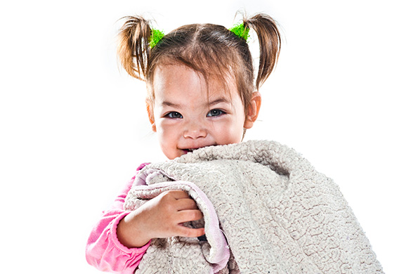 toddler holding her blanket