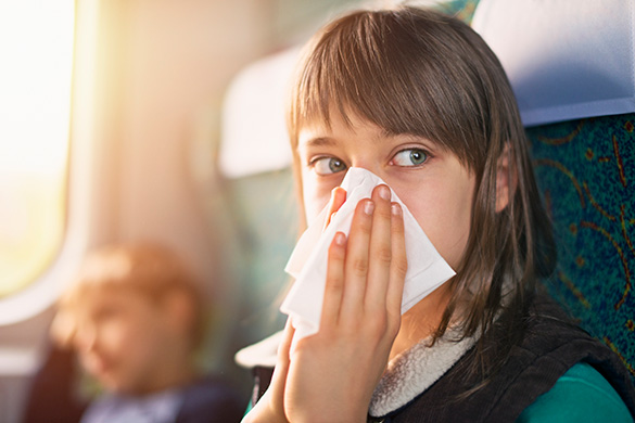 girl becoming sick going on vacation