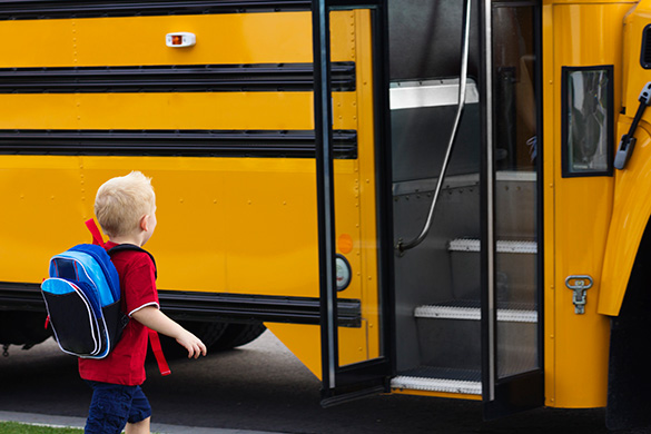 young child getting on bus