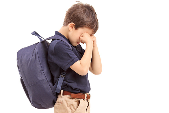 school age boy crying