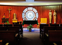 The beautiful stained glass feature is from the original chapel built in 1931.