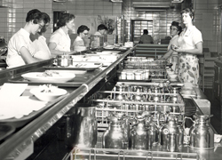 Busy workers in the kitchen at McKennan Hospital, circa 1960.