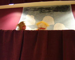 a staff puppet show on stage