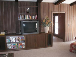 The south living room is a favorite area for guests to gather for TV and movies. Books and magazines are available. A recliner is also located in this room.