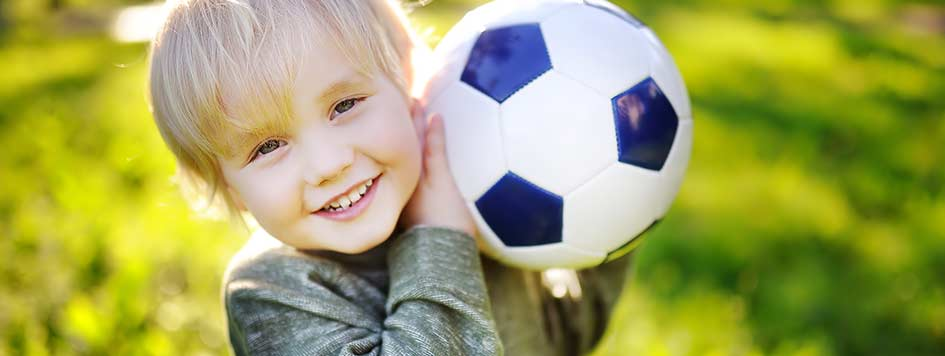 Smiling boy with soccer ball