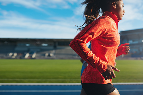 young female athlete running