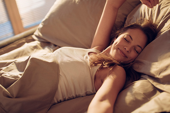 woman waking up rested