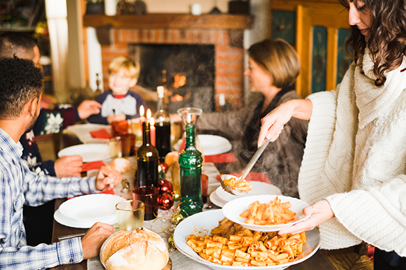 Family Gathering around Holiday Table