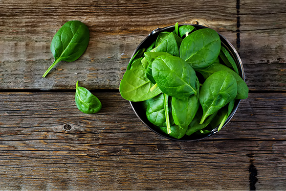 Spinach Bowl on Wood Floor