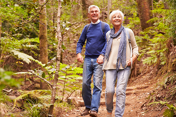 retired couple being active hiking