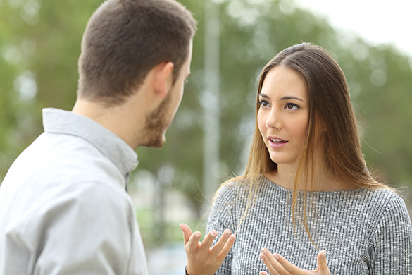 woman talking to a man