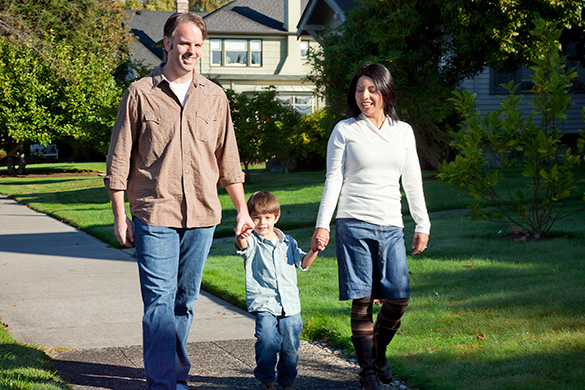 family walking in their neighborhood