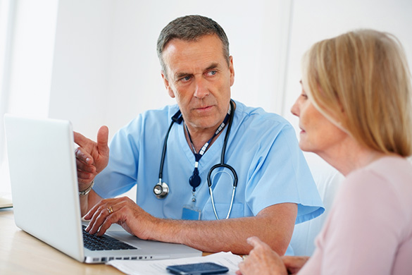 doctor and patient discussing results at a computer
