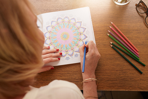 mature woman using a coloring book