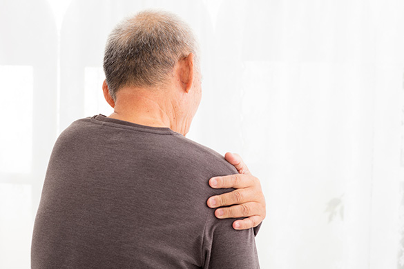senior man having shoulder pain