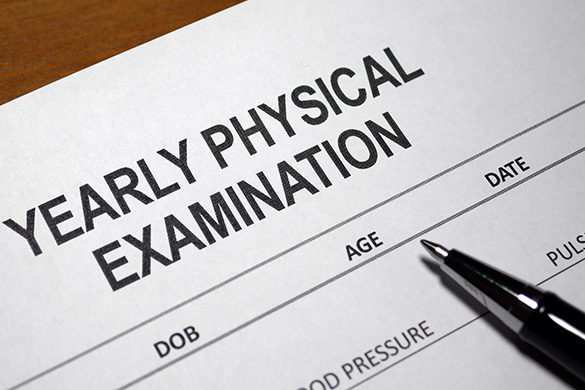 yearly physical exam form and pen