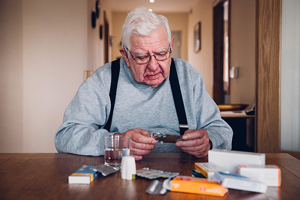 senior man organizing his medications