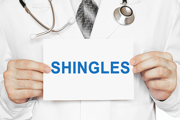 doctor holding shingles sign
