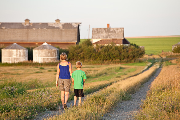 Mother and Son Walking in Rural South Dakota