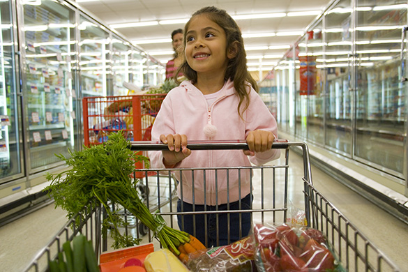 child at grocery store helping mom shop