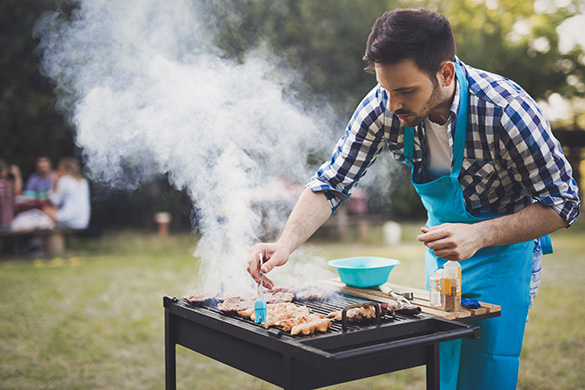 man grilling for friends