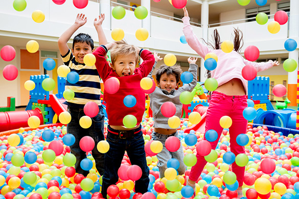 kids playing in a pool of balls