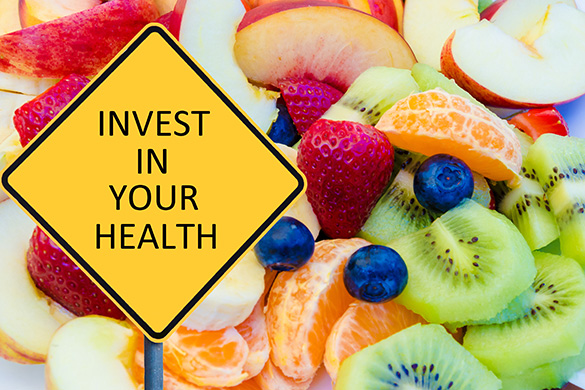 invest in your health sign and fresh fruit