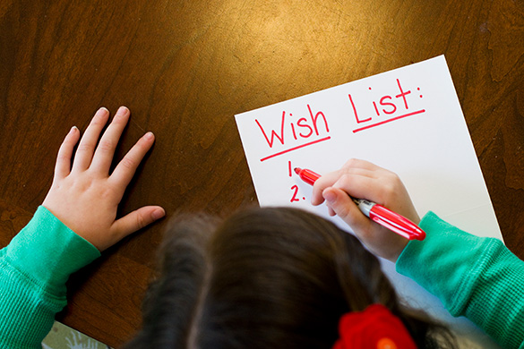 little girl making her holiday wish list