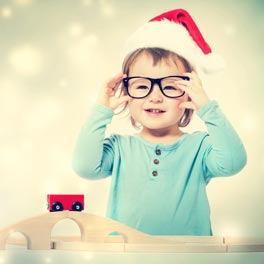 Young Girl with Glasses and Santa Hat with Toys