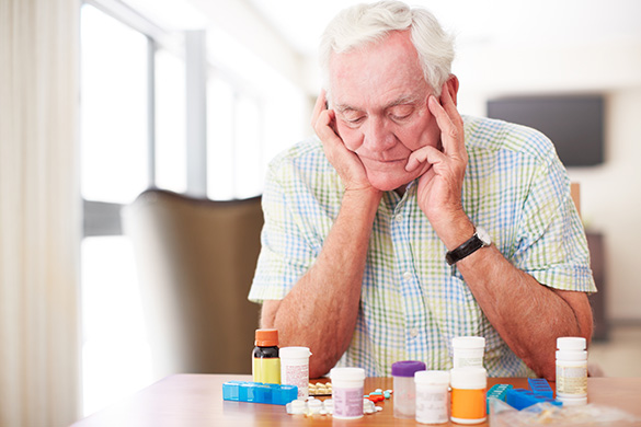 senior man confused about medications