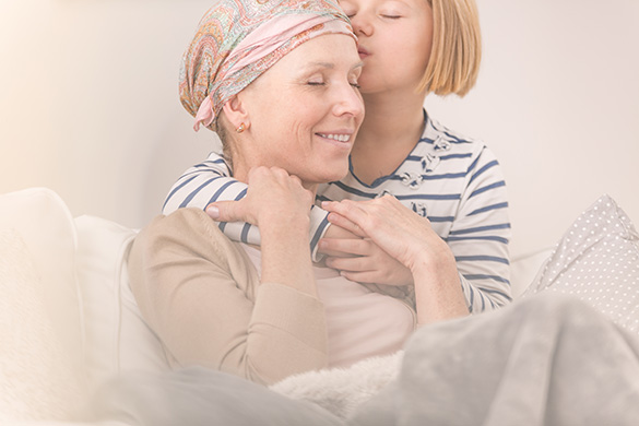 woman going through chemotherapy comforted by daughter