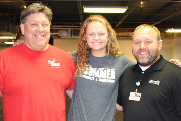 emily oswald with coach rozy and trevor woods