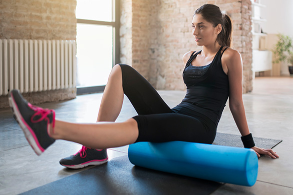 woman exercising using a foam roller